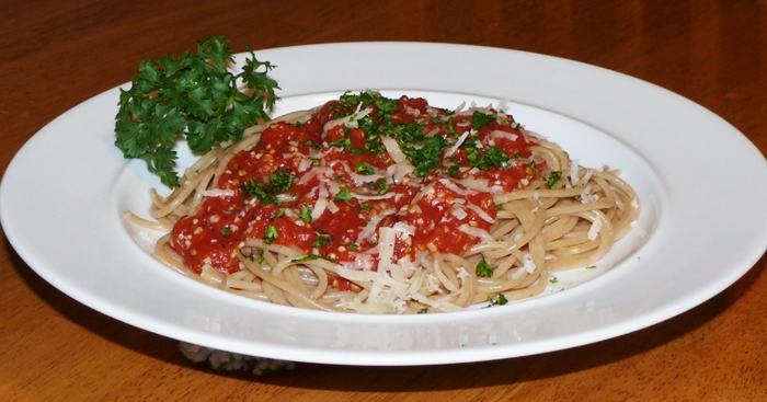 Whole Wheat spaghetti, homemade sauce, fresh chopped parsley, fresh parmesan